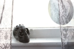 A clay skull on windowsill.